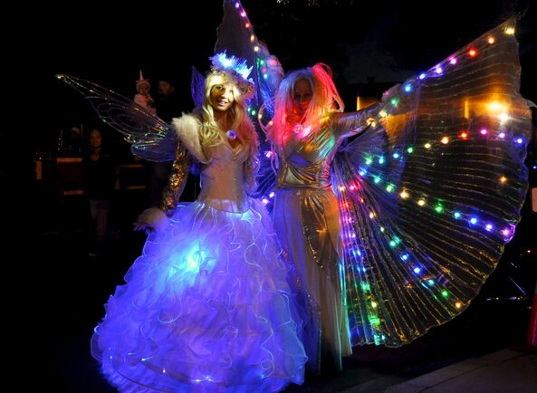 glowing snow fairy and isis wings performers for holiday party